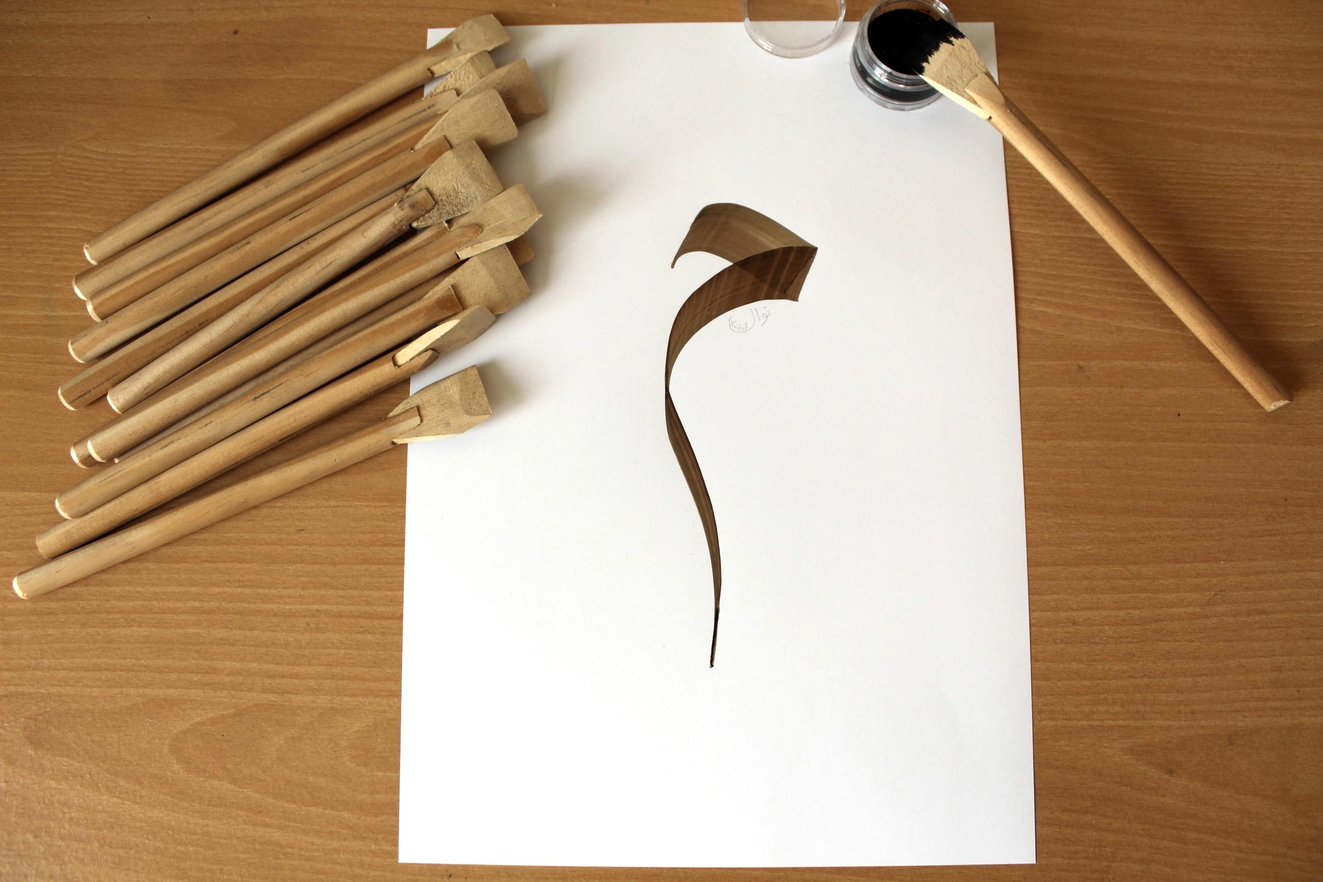 Lettre Mim calame calligraphie arabe